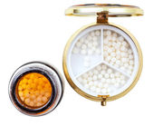 Compact pill box and jar with homeopathy balls — Stock Photo