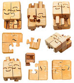 Set of three dimensional wooden mechanical puzzle — Stock Photo