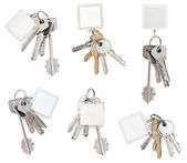 Set of bunch of door keys with blank keychain — Stock Photo