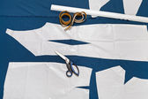 Tailor tools and paper sample of clothes — Стоковое фото