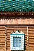 Decorated window of old russian log house — Zdjęcie stockowe