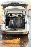 Set of tires in boot of car — Stock fotografie