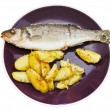 Top view of seabass and fried potatoes in plate — Stock Photo