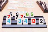 Tile sets in playing rack of Rummikub board game — Stockfoto