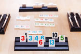Playing in Rummikub card board game — Stock Photo