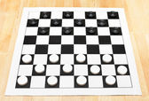 Starting position on vinyl checkers board — Stock Photo
