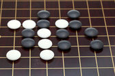 Position of stones during go game — Stock Photo