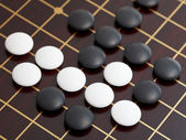 Above view of stones during go game playing — Stock Photo