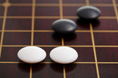 Few stones during go game playing on goban — Foto Stock