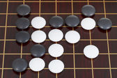 Top view of many black and white go game stones — Stock fotografie