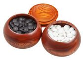 Set of go game stones in wooden bowls — Stock Photo