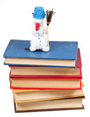Felt soft toy snowman on stack of books — Foto Stock