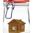Timber house in glass jar — Stock Photo