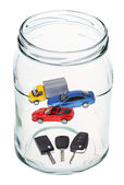 Cars and keys in open glass jar — Stock Photo