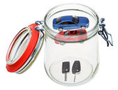 New cars and keys in glass jar — Stock Photo
