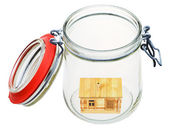 Wooden house in glass jar — Stock Photo
