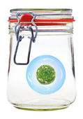 Little green rural planet in glass jar — Stock Photo