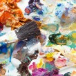 Palette with strokes of oil paints — Stock Photo