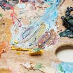 Oil paint brush strokes on wooden artistic palette — Stock Photo #44652771