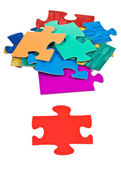 Red piece near pile of jigsaw puzzles — Stock Photo