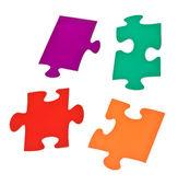 Four separated jigsaw puzzle pieces — Zdjęcie stockowe
