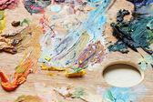 Oil paint brush strokes on wooden artistic palette — ストック写真