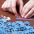 Playing with jigsaw puzzles — Stock Photo