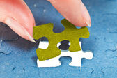 Inserting the last piece of puzzle — Stock Photo