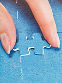 Attaching the last piece of puzzle — Stock Photo