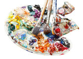 Used pallette with oils, paint brushes, tubes — Stock Photo