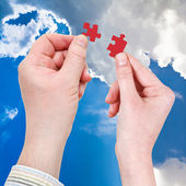 Male and female hands with little puzzle pieces — Stock Photo