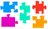 Set of different multicolored puzzle pieces — Stock Photo