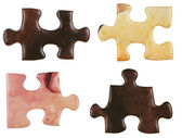 Set of brown little puzzle pieces — Stock Photo