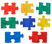 Set of colored painted puzzle pieces — Stock Photo