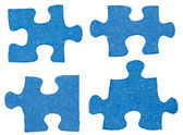 Set of blue little puzzle pieces — Stock Photo