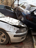 Three broken cars during road accident — Стоковое фото