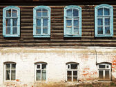 Wall of old russian urban wooden house — Stock Photo