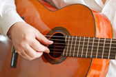 Man playing classical acoustic guitar — Stock Photo
