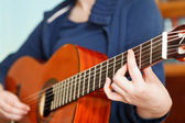 Girl playing classical acoustic guitar — Stock Photo