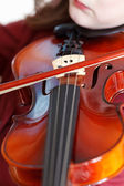 Girl playing violin by bow — Foto de Stock