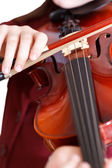 Girl plays on violin by bow isolated — Stock Photo