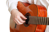 Man plays on typical acoustic guitar isolated — Stock Photo