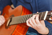Girl plays on classical acoustic guitar — Stock Photo