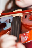 Child playing violin by bow — Stock Photo