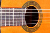 Fingerboard and sound hole of acoustic guitar — Стоковое фото