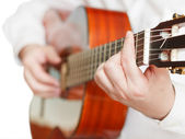 Man playing classical guitar close up isolated — Stockfoto