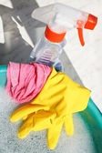 Rubber glove, duster, spray bottle, soapsuds water — Stock Photo
