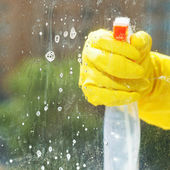 Soapy detergent on window glass during washing — Stock Photo