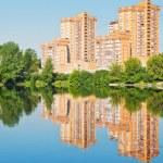 Brick apartment houses on urban lakeside — Stock Photo #46900025