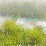 Raindrops on windowpane in summer day — Stock Photo #47385199